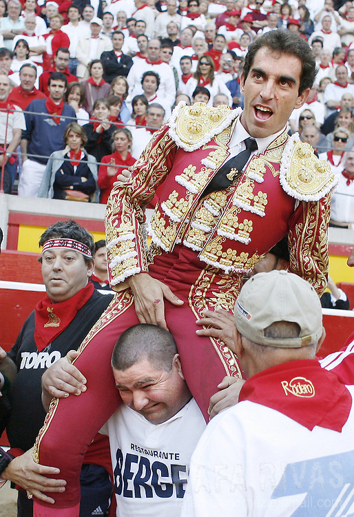 Spanish matador Salvador Cortes is paraded after receiving his Fuente Ymbro fighting bulls' ears during the third corrida of the San Fermin festivities, 09 July 2006, in Pamplona, northern Spain.