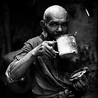 Damollan, 60-year-old Uyghur blacksmith sips his tea during a short break from his 10-hour work day. Katman Bazaar is a small block located in the Old city of Kashgar in the Xinjiang province of China. The Uyghur blacksmiths have worked in these quarters for hundreds of years. Like most parts of the ancient Kashgar, Katman Bazaar is now under constant danger of being demolished for the sake of urban development supported by the Chinese government.