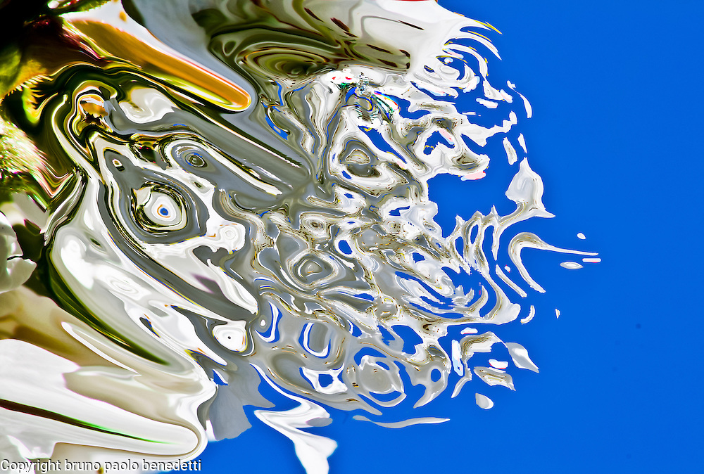 In an  falling abstract fluid shape colors change into white