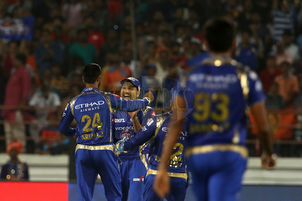 Krunal Pandya of the Mumbai Indians and Mumbai Indians captain Rohit Sharma celebrates the wicket of Ravindra Jadeja of the Gujarat Lions during match 35 of the Vivo 2017 Indian Premier League between the Gujarat Lions and the Mumbai Indians  held at the Saurashtra Cricket Association Stadium in Rajkot, India on the 29th April 2017<br /> <br /> Photo by Vipin Pawar - Sportzpics - IPL