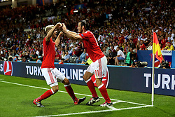 TOULOUSE, FRANCE - Monday, June 20, 2016: Wales' Gareth Bale celebrates scoring the third goal against Russia, with team-mate Aaron Ramsey, to seal a 3-0 victory and top Group B during the final Group B UEFA Euro 2016 Championship match at Stadium de Toulouse. (Pic by David Rawcliffe/Propaganda)