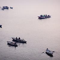 Hindu pilgrims gather at the banks of the Ganges river at the holy city of Varanasi, also known as Benares...Photo: Tom Pietrasik.Varanasi, Uttar Pradesh, India.February 4th 2010