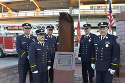 Sept. 11, 2015 - Bellmore, New York, United States - L-R, Bellmore Fire Dept. Chief DANIEL HOLL, Pastor and Chaplain JAMES BARNUM, 1st Deputy VINCENT MONTERA, 2nd Deputy TOM STOERGEN, and Chaplain DENNIS RICH stand next to a monument that's a piece of structural steel from the Twin Towers, during the Bellmore Memorial Ceremony for 3 Bellmore volunteer firefighters and 7 residents who died due to 9/11 NYC terrorist attacks. Elevated platform of Bellmore LIRR Station is in background. (Credit Image: © Ann Parry via ZUMA Wire)