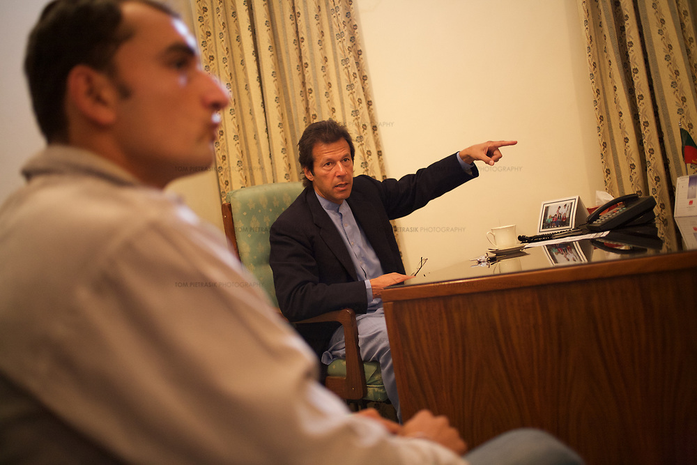 Imran Khan discusses constituency issues with fellow Tehrik-e-insaaf party members and constituents in his Parliamentary office in Islamabad. Khan is MP for Mianwali in Panjab.<br /> <br /> Cricketer Imran Khan made his Test debut against England in 1971. He became captain of the Pakistan team in 1982 and lead them to World Cup victory in 1992 after which he retired.<br /> <br /> Imran Khan established the Tehrik-e-insaaf (or Moverment for Justice) in 1996. Through Tehrik-e-insaaf, Khan has demanded that the Pakistan government make institutional reforms to address corruption and end the present dictatorship. Khan would like a more equitable distribution of resources in Pakistan, the granting key civil liberties and an increas in public service spending. He is particularly scathing of the relationship between President Musharraf and US President Bush.<br /> <br /> Imran Khan became a Member of the Pakistani Parliament for Mianwali, Panjab, in the October 2002 elections.<br /> <br /> Photo: Tom Pietrasik<br /> Islamabad Pakistan<br /> 27th January 2006