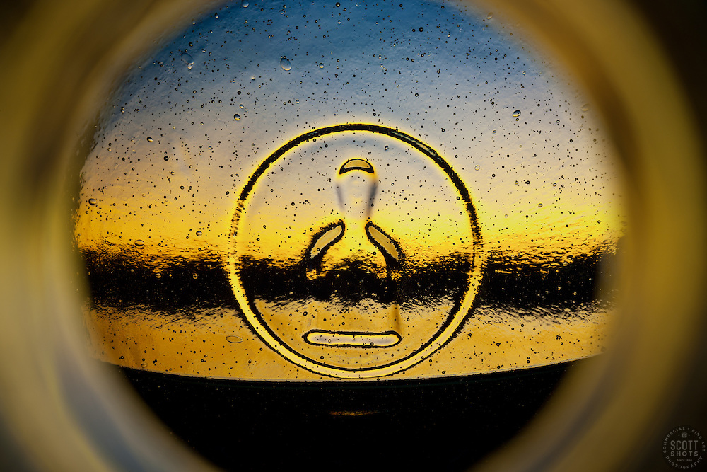 """Beauty at the Bottom: Tequila Sunrise 7"" - This is a photograph of a tequila bottle, shot right down inside the mouth of the bottle."