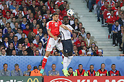 Switzerland Defender Ricardo Rodríguez heads with France Defender Bacary Sagna during the Euro 2016 Group A match between Switzerland and France at Stade Pierre Mauroy, Lille, France on 19 June 2016. Photo by Phil Duncan.