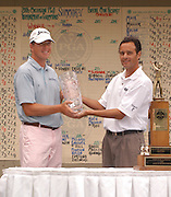 Michael Harris from Milwaukee, Wisconsin (left) accepts the winners trophy for the 2006 Tournament of Champions from Boyne Resorts Stephen Kircher (right) after successfully defending his title at Boyne Mountain.