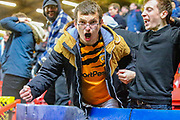 Hull City fans celebrate after their team equalises in injury time during the EFL Sky Bet Championship match between Charlton Athletic and Hull City at The Valley, London, England on 13 December 2019.