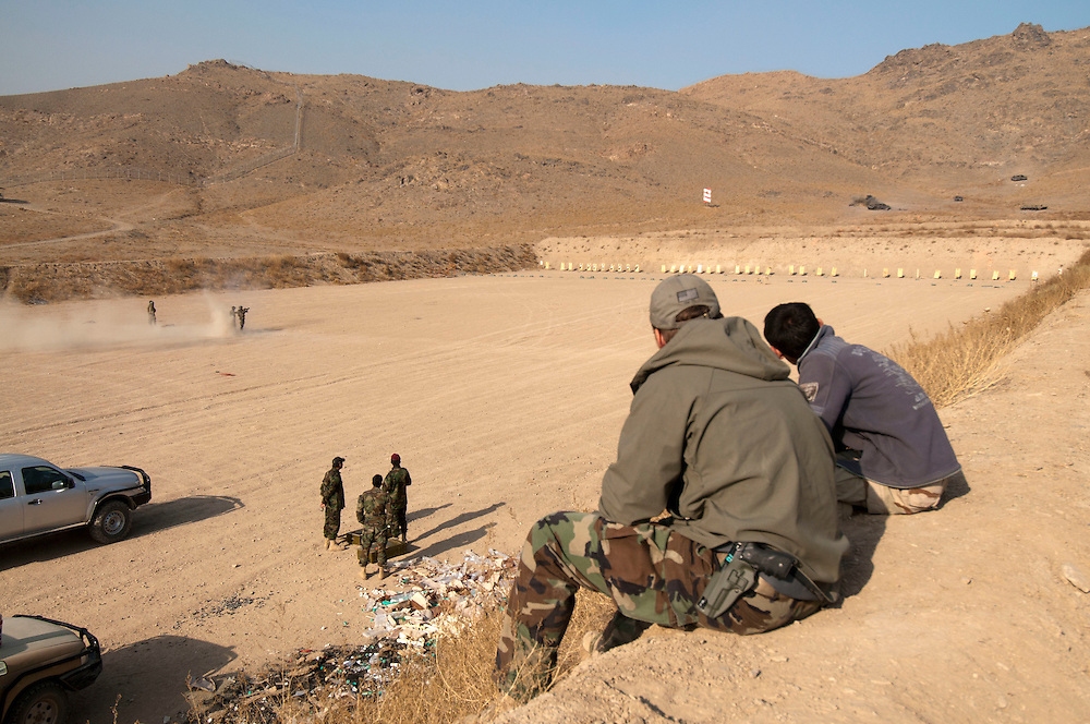 US Special Forces mentor Afghan Commandos at Camp Morehead, Rish Khvor, Afghanistan.  The camp was a former training facility for the Soviet Army and later the Taliban.