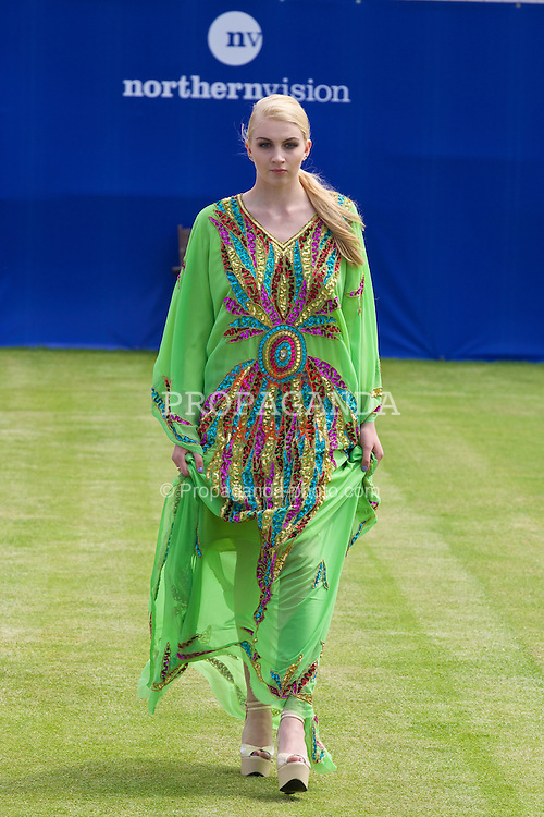 LIVERPOOL, ENGLAND - Thursday, June 19, 2014: A Fashion Show during Day One of the Liverpool Hope University International Tennis Tournament at Liverpool Cricket Club. (Pic by David Rawcliffe/Propaganda)