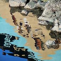 reflected light creating watercolor effect on water by rocks.<br /> <br /> fine art,watercolor,rocks,water,reflection,waterdrop