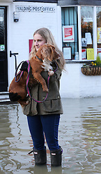 Boxing Day floods.. Resident Olivia Highwood and her dog Fudge  survey the scene in Yalding, Kent  as villagers   brace themselves for the possibility of more flooding with another storm on the way, Thursday, 26th December 2013. Picture by Stephen Lock / i-Images