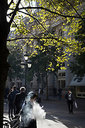 A vaper standing in Autumn sunshine exhales smoke from his eCigarette, on 27th October 2017, in the City of London, England.