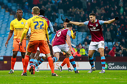 Rudy Gestede of Aston Villa celebrates after Ciaran Clark (pictured) scores a goal to make it 1-0 - Mandatory byline: Rogan Thomson/JMP - 19/01/2016 - FOOTBALL - Villa Park Stadium - Birmingham, England - Aston Villa v Wycombe Wanderers - FA Cup Third Round Replay.