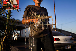 A man sells  rosaries made of rhinestones on the streets of Culiacan. Mexico's Narco Culture is marked by conspicuous consumption and ostentatious displays of wealth.