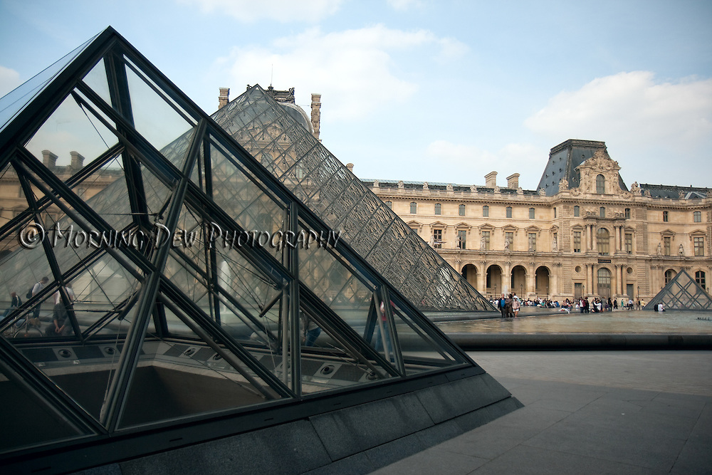 I.M. Pei's glass pyramids dominate the courtyard of the Louvre Museum.