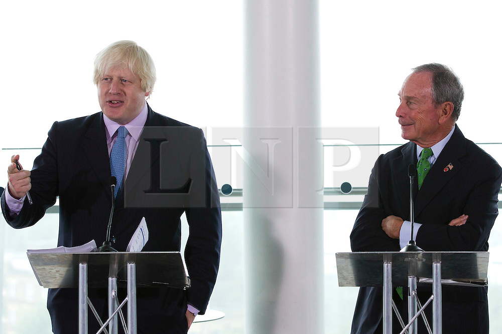 © Licensed to London News Pictures. 24/09/2013. London, UK. Boris Johnson (L), the Mayor of London and Michael Bloomberg, the Mayor of New York, are seen at the launch of the 2013-2014 Mayor's Challenge at City Hall in London today (24/09/2013). The competition, sponsored by Bloomberg Philanthropies, aims to aid cities to come up with bold solutions to urban challenges  Photo credit: Matt Cetti-Roberts/LNP