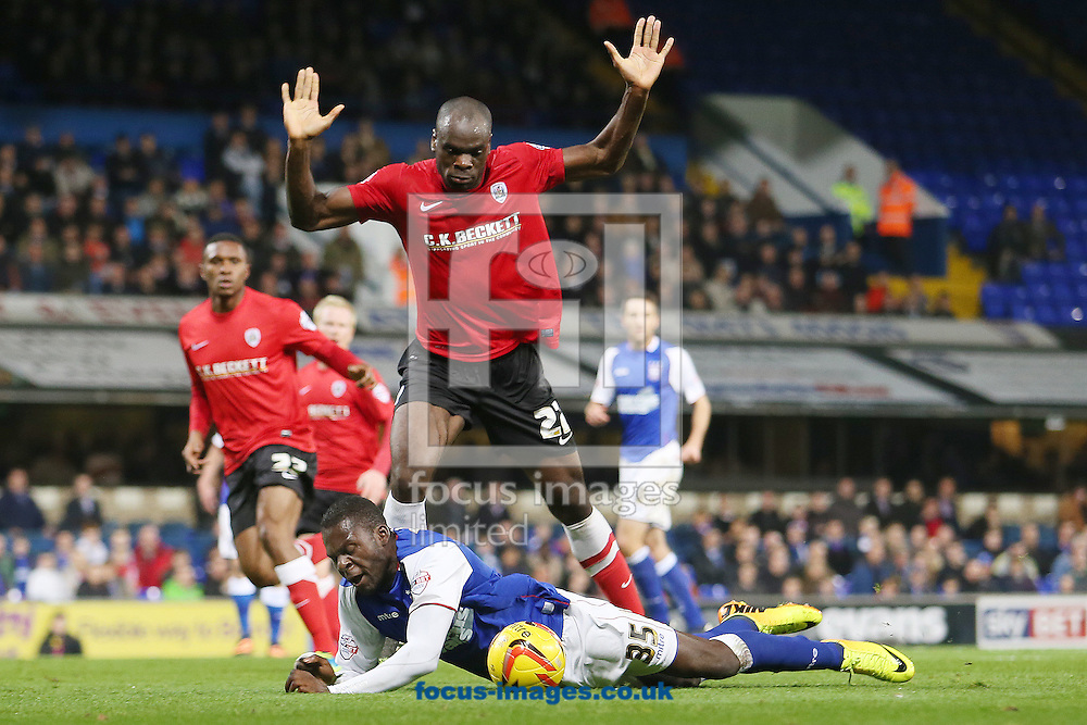 Picture by Richard Calver/Focus Images Ltd +447792 981244<br /> 01/11/2013<br /> Frank Nouble of Ipswich Town goes down in the area after a challenge from Jean-Yves Mvoto of Barnsley during the Sky Bet Championship match at Portman Road, Ipswich.