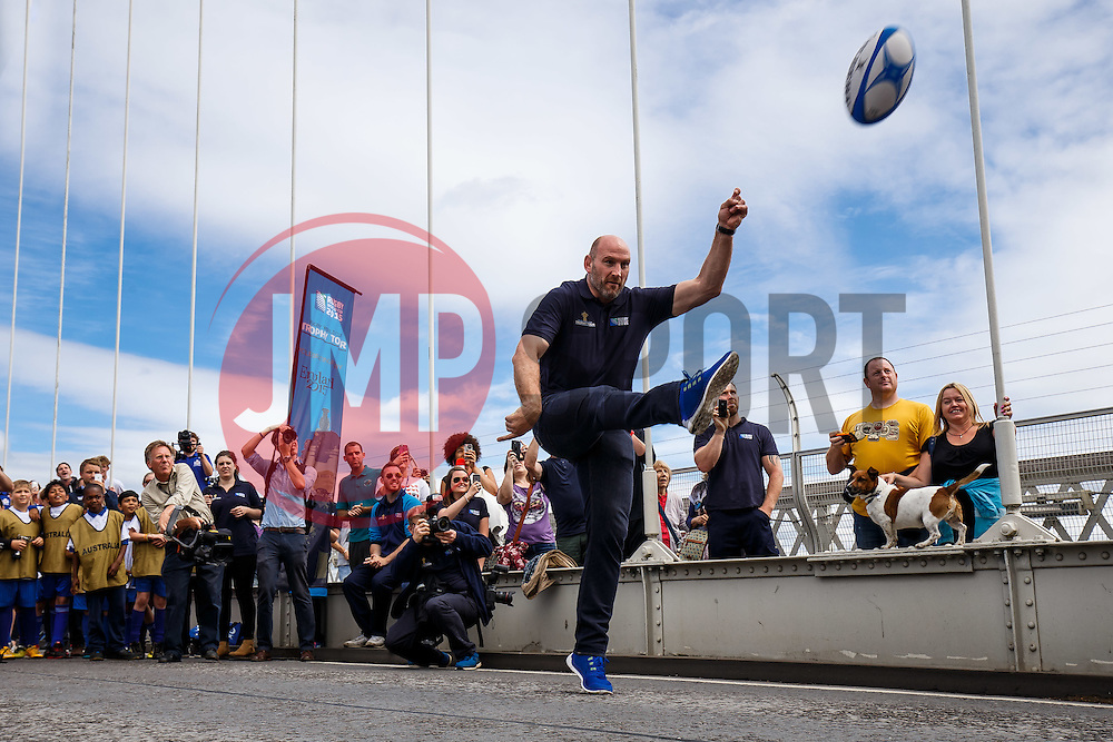 Lawrence Dallaglio attempts to kick a ball over the bridge supports and Local Junior Schools take part in activities on the iconic Clifton Suspension Bridge with Bristol Rugby Players as the Webb Ellis Cup visits Bristol as part of the Rugby World Cup Trophy Tour - Mandatory byline: Rogan Thomson/JMP - 07966 386802 - 14/07/2015 - SPORT - RUGBY UNION - Bristol, England - Clifton Suspension Bridge.