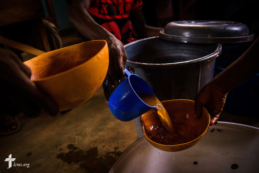 Tchakpah, a millet beer commonly brewed in Togo, is poured for fellowship following a Bible study at the Lutheran Church of Togo in Lokpano on Monday, Feb. 13, 2017, in Lokpano, Togo. LCMS Communications/Erik M. Lunsford