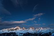 The group of the Bergüner Stöcke with the peaks Piz Mitgel, Corn da Tinizong and Piz Ela, Parc Ela at dusk, Grisons, Switzerland