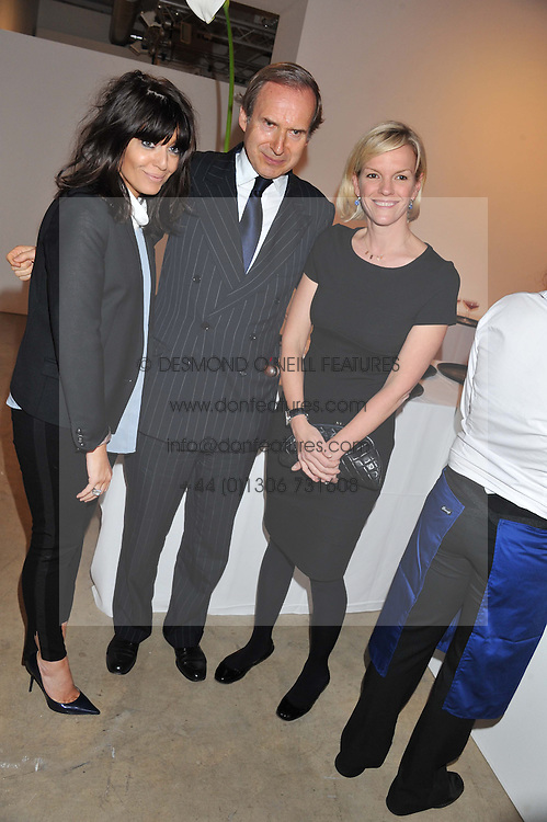 Left to right, CLAUDIA WINKLEMAN, SIMON DE PURY and ELISABETH MURDOCH at a dinner in aid The Journalism Foundation held at Philips De Pury & Company, Howick Place, London, SW1 on 22nd May 2012.