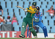 PRETORIA, South Africa, 11 December 2013. Quinton de Kock of South Africa batting with Mahendra Singh Doni of India at the wicket during the 3rd ODI Cricket match between South Africa and India at Super Sport Park in Centurion Pretoria, South Africa on Wednesday 11 December 2013.<br /> Photographer : Anton de Villiers / SASPA