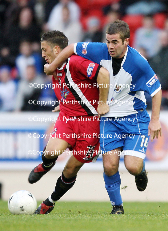 St Johnstone v Clyde....27.10.07<br /> Peter MacDonald is held by Michael McGowan<br /> Picture by Graeme Hart.<br /> Copyright Perthshire Picture Agency<br /> Tel: 01738 623350  Mobile: 07990 594431