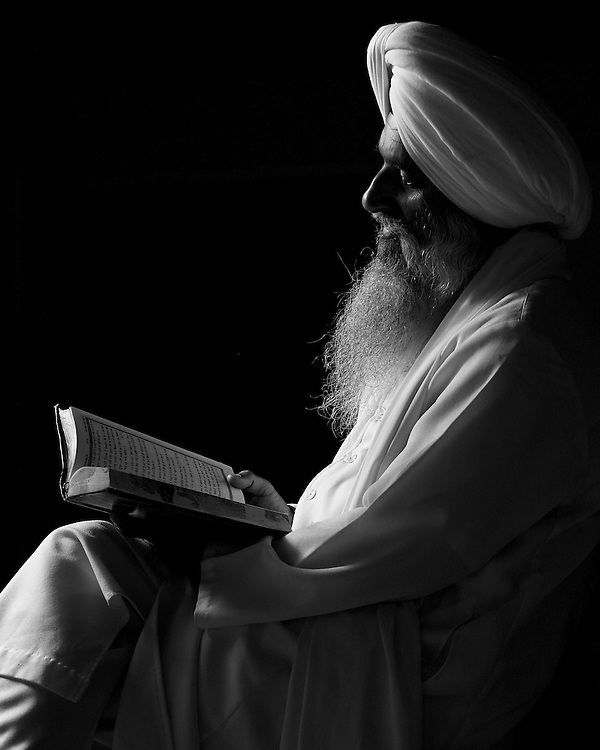 Kulwant Singh reading Guru Granth Sahib.