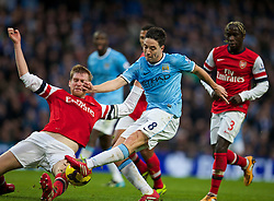14.12.2013, Etihad Stadium, Manchester, ENG, Premier League, Manchester City vs FC Arsenal, 16. Runde, im Bild Manchester City's Samir Nasri, action against Arsenal's captain Thomas Vermaelen // during the English Premier League 16th round match between Manchester City and Arsenal FC at the Etihad Stadium in Manchester, Great Britain on 2013/12/14. EXPA Pictures © 2013, PhotoCredit: EXPA/ Propagandaphoto/ David Rawcliffe<br /> <br /> *****ATTENTION - OUT of ENG, GBR*****