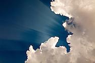 Cumulus clouds and sunlight streaks