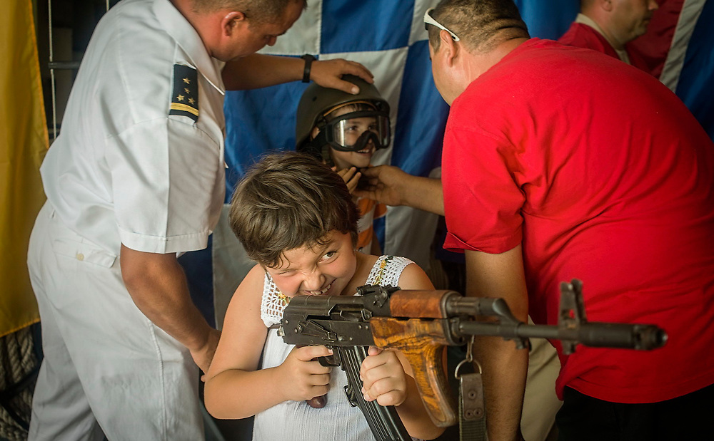 Kids are playing with real weapons (unloaded) during during the Romanian Navy Day. Constanta, Romania
