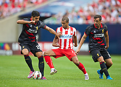 CHICAGO, USA - Sunday, July 27, 2014: Liverpool's Emre Can in action against Olympiacos' Mathieu Dossevi during the International Champions Cup Group B match at the Soldier Field Stadium on day seven of the club's USA Tour. (Pic by David Rawcliffe/Propaganda)