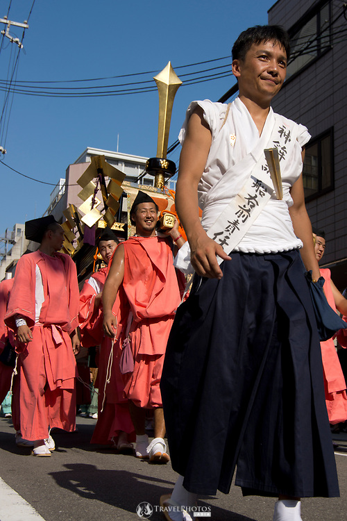 Men carrying a palanquin in the Tenjin Festival (Tenjin Matsuri) in Osaka.