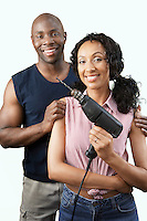 Couple Holding Power Drill