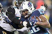 NASHVILLE, TN - DECEMBER 31:  Derrick Henry #22 of the Tennessee Titans runs the ball during a game against the Jacksonville Jaguars at Nissan Stadium on December 31, 2017 in Nashville, Tennessee.  The Titans defeated the Jaguars 15-10.  (Photo by Wesley Hitt/Getty Images) *** Local Caption *** Derrick Henry