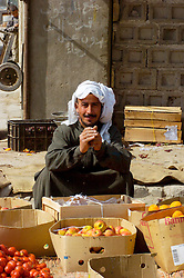 One Iraqi man sits at his fruit  stall on the street of a small town close to Basra in Southern Iraq March 2005