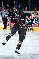 KELOWNA, CANADA -FEBRUARY 5:  Haydn Fleury D #4 of the Red Deer Rebels takes a shot during warm up against the Kelowna Rockets on February 5, 2014 at Prospera Place in Kelowna, British Columbia, Canada.   (Photo by Marissa Baecker/Getty Images)  *** Local Caption *** Haydn Fleury;