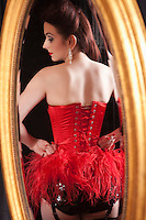 Showgirl reflected in mirror