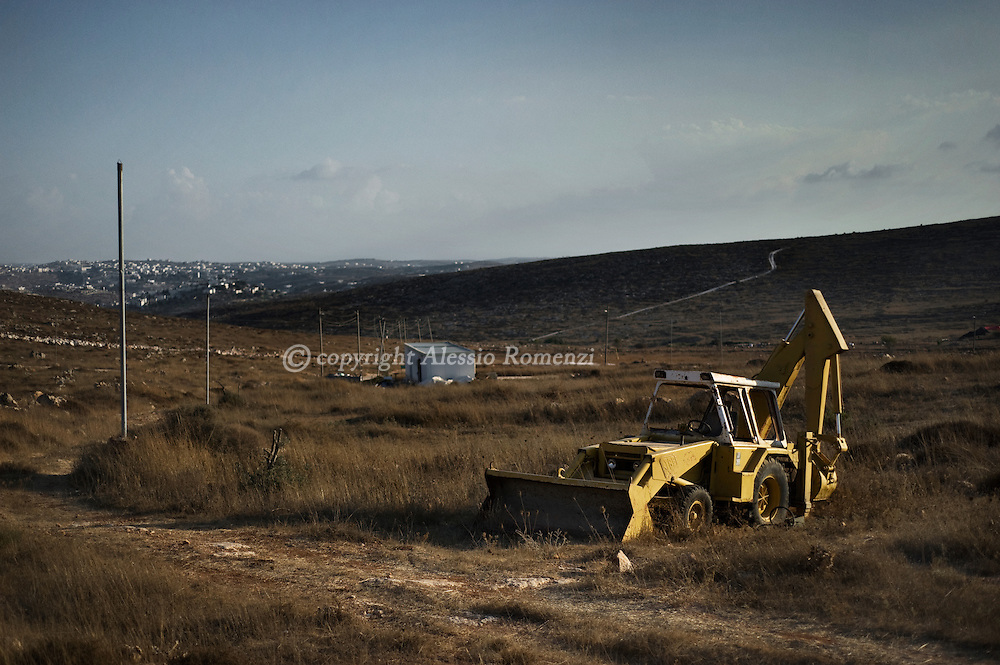 A abandoned bulldozernear the Jewish settlement of Beit Hagai in the occupied West Bank region of Hebron on September 2, 2010, while Palestinian leader Mahmud Abbas resumed direct talks with Israeli Premier Benjamin Netanyahu, calling on the Jewish state to end all settlement activity in Palestinian land and to lift the blockade on the Gaza Strip..© ALESSIO ROMENZI
