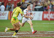 England's Will Edwards makes a break during the HSBC World Rugby Sevens Series - Singapore, Bronze match Australia-V-England at The National Stadium, Singapore on Sunday, April 16, 2017. (Steve Flynn/Image of Sport)