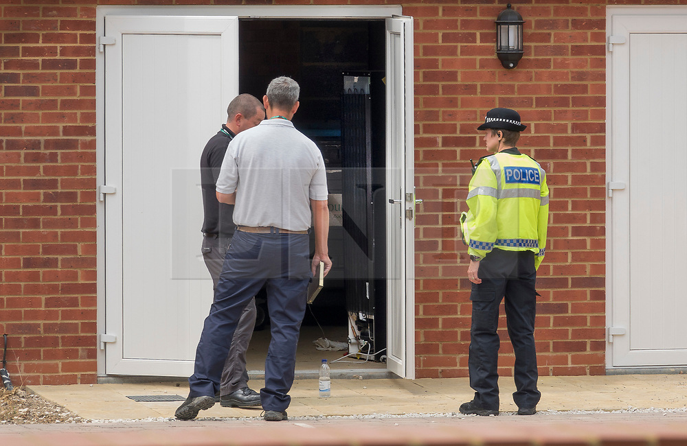 © Licensed to London News Pictures. 04/07/2018. Amesbury, UK. Police stand outside a lock-up near the entrance of a property in Muggleton Road, Amesbury after a couple named locally as Dawn Sturgess, 44, and her partner Charlie Rowley, 45, were taken ill on Saturday 30th June 2018. Police have confirmed that the couple have been in contact with Novichok nerve agent. Former Russian spy Sergei Skripal and his daughter Yulia were poisoned with Novichok nerve agent in nearby Salisbury in March 2018.Photo credit: Peter Macdiarmid/LNP