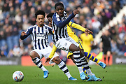 West Bromwich Albion defender Nathan Ferguson (36) fouls Swansea City midfielder Nathan Dyer (12) during the EFL Sky Bet Championship match between West Bromwich Albion and Swansea City at The Hawthorns, West Bromwich, England on 8 December 2019.