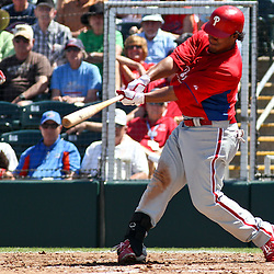 March 13, 2011; Fort Myers, FL, USA; Philadelphia Phillies left fielder Delwyn Young (24) hits a three run homeun during a spring training exhibition game against the Minnesota Twins at Hammond Stadium.   Mandatory Credit: Derick E. Hingle