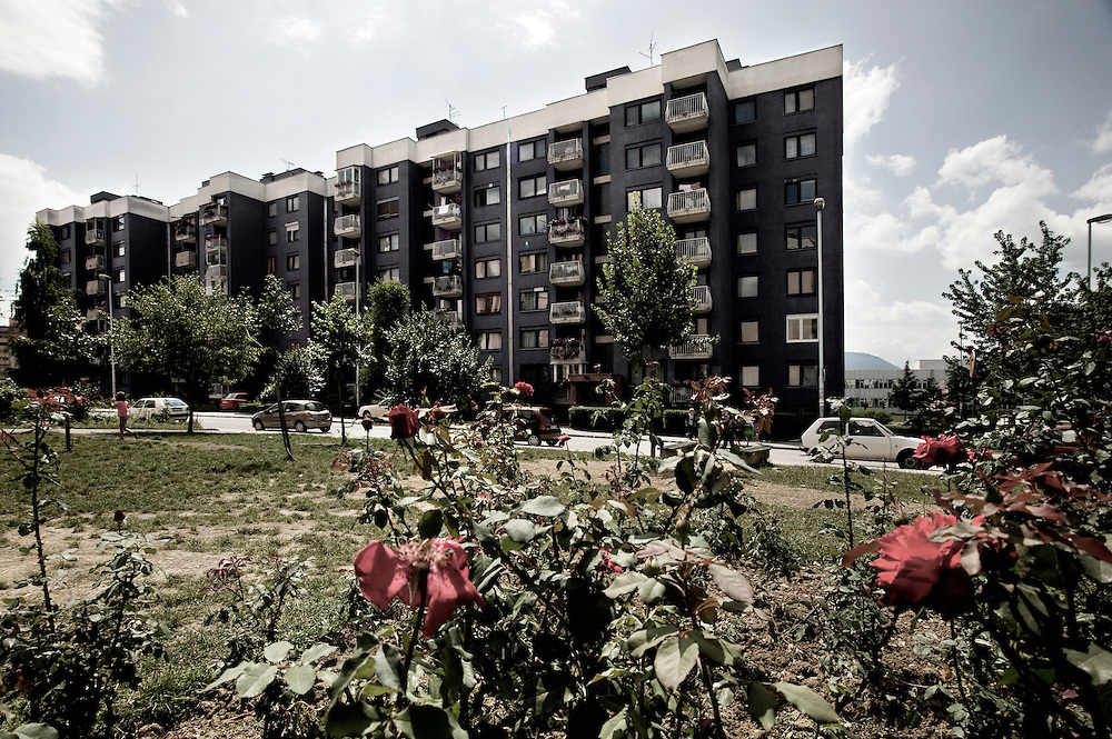 Sarajevo .One of the building blocks of  Mojmilo Olympic village. The village was built in 1984 in the suburb of Sarajevo for the winter Olympics. During the war the village has been almost razed to the ground. One year after the end of the war Barcelona's city rebuilt the most part of the buildings renewing about two thousand flats. Since then new bushes of wild roses are replacing the old war marks called Sarajevo's roses.