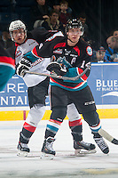 KELOWNA, CANADA - DECEMBER 5: Tyler Mrkonjic #10 of Prince George Cougars back checks Rourke Chartier #14 of Kelowna Rockets on December 5, 2014 at Prospera Place in Kelowna, British Columbia, Canada.  (Photo by Marissa Baecker/Shoot the Breeze)  *** Local Caption *** Tyler Mrkonjic; Rourke Chartier;