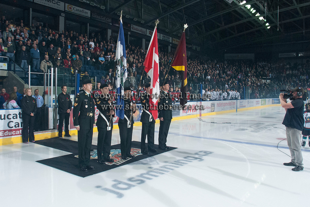 KELOWNA, CANADA - NOVEMBER 9:  Members of Canada's military stand on the ice for a Remembrance Day ceremony at the start of the game of the Red Deer Rebels at the Kelowna Rockets on November 9, 2012 at Prospera Place in Kelowna, British Columbia, Canada (Photo by Marissa Baecker/Shoot the Breeze) *** Local Caption ***