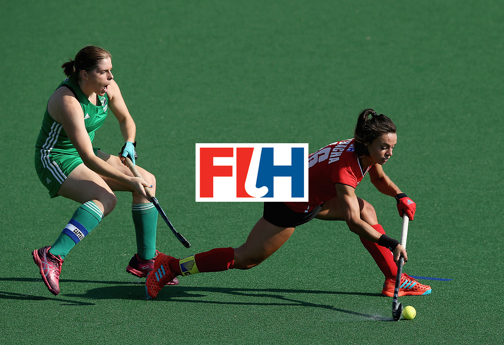 JOHANNESBURG, SOUTH AFRICA - JULY 12: Marlena Rybacha of Poland attempts a pass under pressure from Kathryn Mullan of Ireland during day 3 of the FIH Hockey World League Semi Finals Pool A match between Ireland and Poland at Wits University on July 12, 2017 in Johannesburg, South Africa. (Photo by Jan Kruger/Getty Images for FIH)