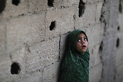 59581100  .A Palestinian refugee girl stands in front of her family house in a poverty-stricken quarter in northern Gaza Strip town Beit Lahiya on April 28, 2013. Reports said that an increasing number of Gazan families are falling further into poverty, with unemployment rates at over 30 percent according to 2012 estimates, on April 28, 2013, 29, April 2013.  Photo by: i-Images.UK ONLY