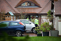 © Licensed to London News Pictures. 31/12/2013, Bosham, UK.  Police at a house at Smuggler's Lane, in Bosham, near Chichester where a murder enquiry has been launched after a 55-year-old woman was found dead with serious head injuries, on Monday morning. Photo Credit: Rob Arnold/LNP